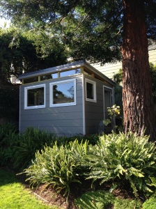 This Modern-Shed home office sits under a Redwood tree and provides a quiet spot for reading and relaxing.
