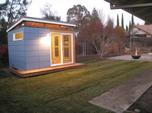 This Modern-Shed home office features open-joint siding and clerestory windows.