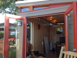 French doors allow an indoor-outdoor feel that keeps the Modern-Shed a part of the home.