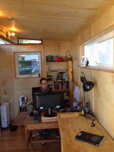 Maya Churi sits inside this 8' by 15' Modern-Shed.