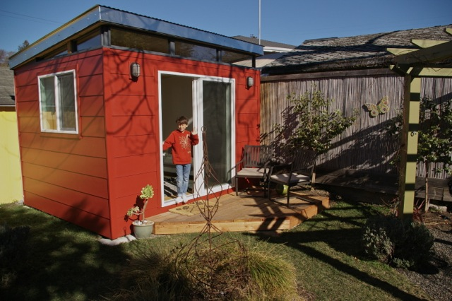 Dylan, 9, hangs out in his mother's Modern-Shed, which has come to have many uses.