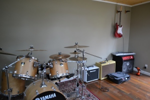Jesse's studio is a space where he can play his drums and guitar.
