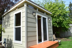 Kevin and Erin share space in their 10' by 12' Modern-Shed home office.