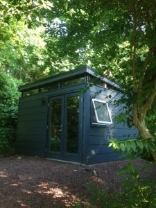 This 14' by 14' Modern-Shed garden studio blends well with David's home.