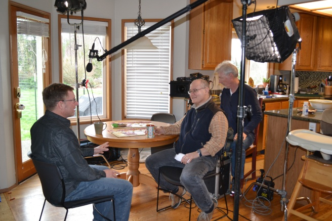 MSNBC producer Frank Silverstein, center, and MSNBC camera man Glenn Aust, at right, set up lighting and sound for Modern-Shed GM Tim Vack's interview.