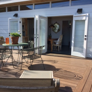 The deck features an outdoor gas barbecue.