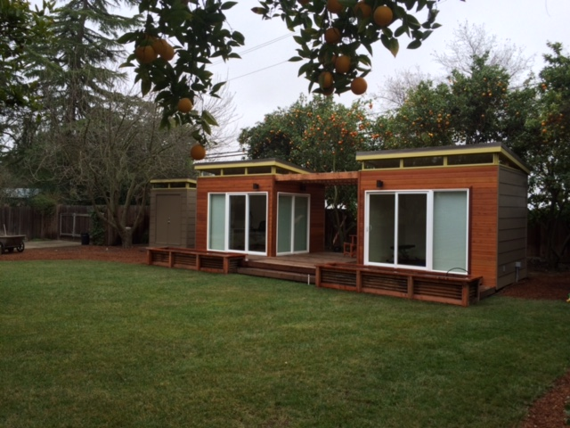 Jim and his wife actually have three Modern-Sheds -- a smaller 6' by 8' garden shed sits to the left of the twin studios.