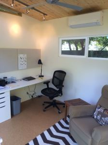 This 10' by 12' Modern-Shed serves as an office and work space for Jim.