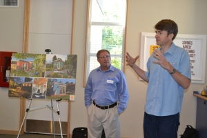 Modern-Shed General Manager Tim Vack and owner Ryan Smith discuss the possibilities for a Modern-Shed at a Peninsula Credit Union event.