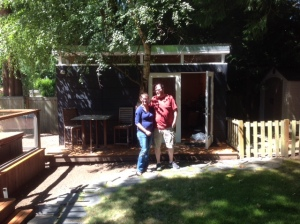 Cory and Jeremy in front of the first Modern-Shed on their property, which they turned into a studio and then a guest suite.