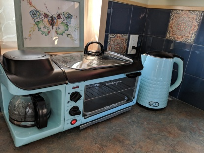 The kitchenette comes with a hot plate, coffee pot, toaster over, hot water heater, microwave and refrigerator/freezer for guests to warm up food.