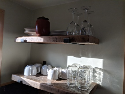 The shelves are made with reclaimed wood from an artist on Etsy