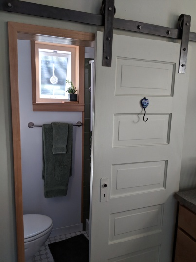 The door to the bathroom comes from Marc and Jeanine's 1911 house